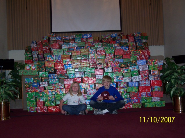 "476 ""gifts of love"" ready for the dedication service the next day during Sunday service."