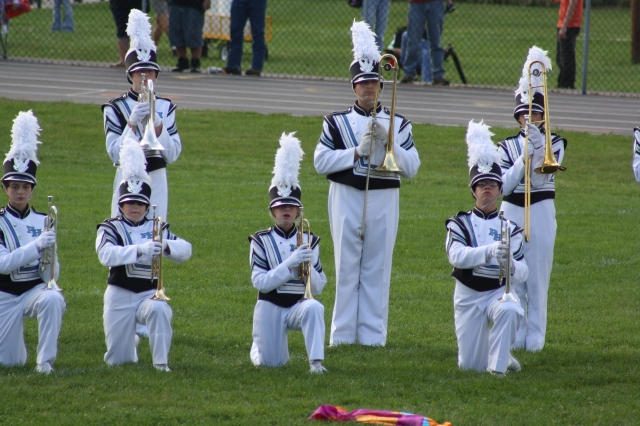 My son is the Mellophone (large silver trumpet like instrument) on the back row. My daughter is kneeling to his left with her trumpet in the first row.