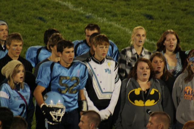 Double duty as part of the Patrick Henry High School choir before the senior year homecoming game.