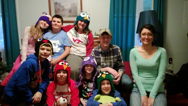 The back row left to right is Meredith, Max, Carrie, Isaac and Kelsey. The front row is Noah, Clay, Anna and Bryson. They are sporting Christmas gifts of Angry Bird toboggans made by their Aunt Vota.