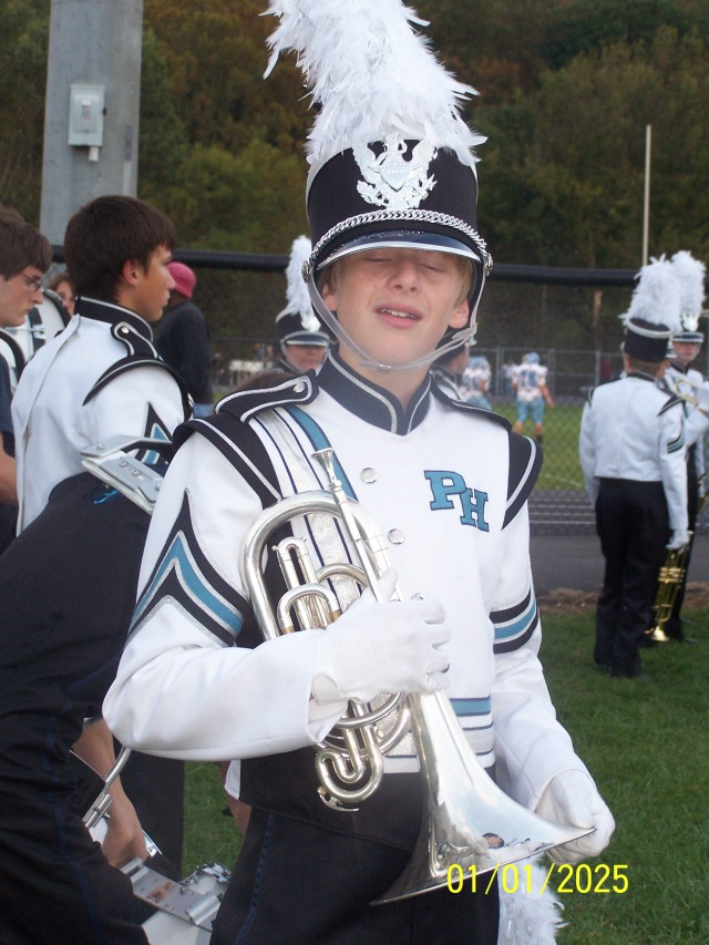 My son as eighth grade member of the high school marching band.