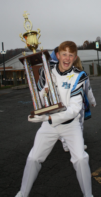 At the final competition of his high school career the band captured a grand champion award and all the seniors got turns hoisting the hardware.