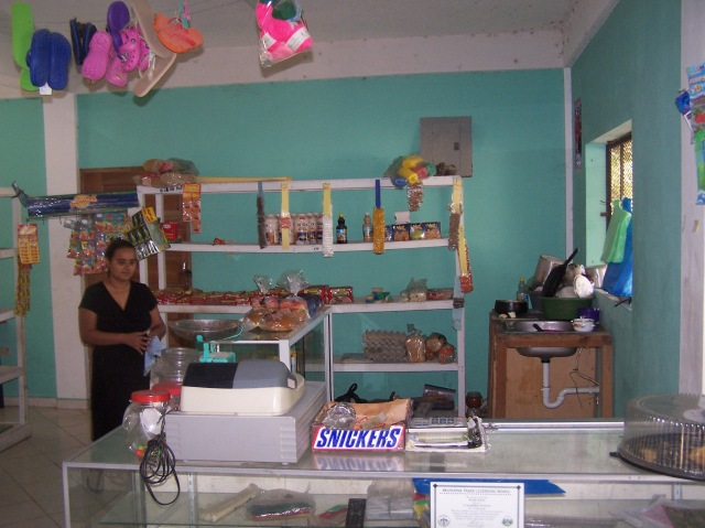 This is another small market in the basement of a home in Belize