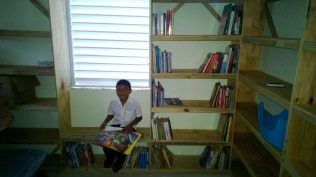 Ivan is the first Heart House kid to enjoy the new library.