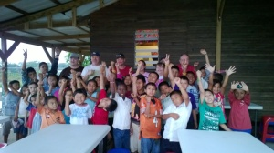 Our mission team and the kids as they show off their new bracelets mad by some kids from my church.