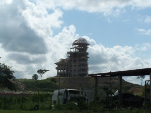 This is a photo of a $5 million dollar mansion in Belmopan Belize and I found it interesting to see a wrecked van on the adjoining property.
