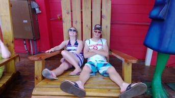 My kids in an oversize chair in Freeport outside of Senor Frogs