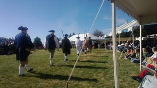At our local Veteran's Day celebration re-enactors dressed in period clothes marched into the celebration casting long shadows in the early November morning.