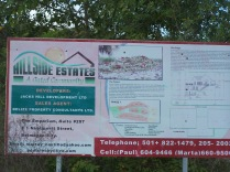 A large sign detailing a large development in Belize that was abandoned.
