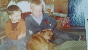 This is a photo from Christmas 1970 of my brother on the left. me and Snoopy.