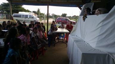 Performing a puppet show for the children at Heart House in Belize. Meredith starred as Mis Bacon.